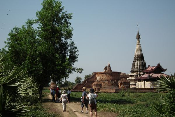 Walking to visit a Buddhist temple, Myanmar