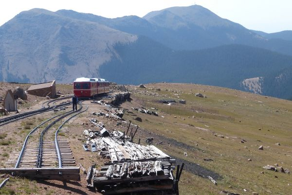 Cog railway train approaching the top of Pikes Peak at 14,115 feet